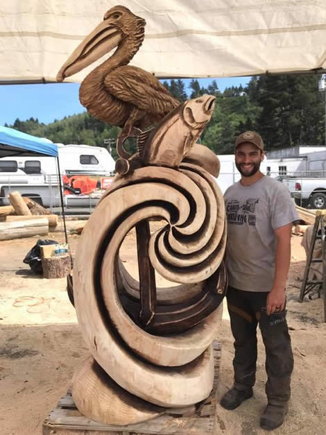 Pelican, fish and wave carving